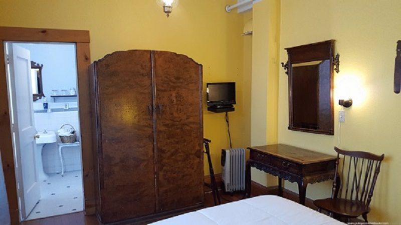 Charlie Chaplin room - armoire and bathroom doorway
