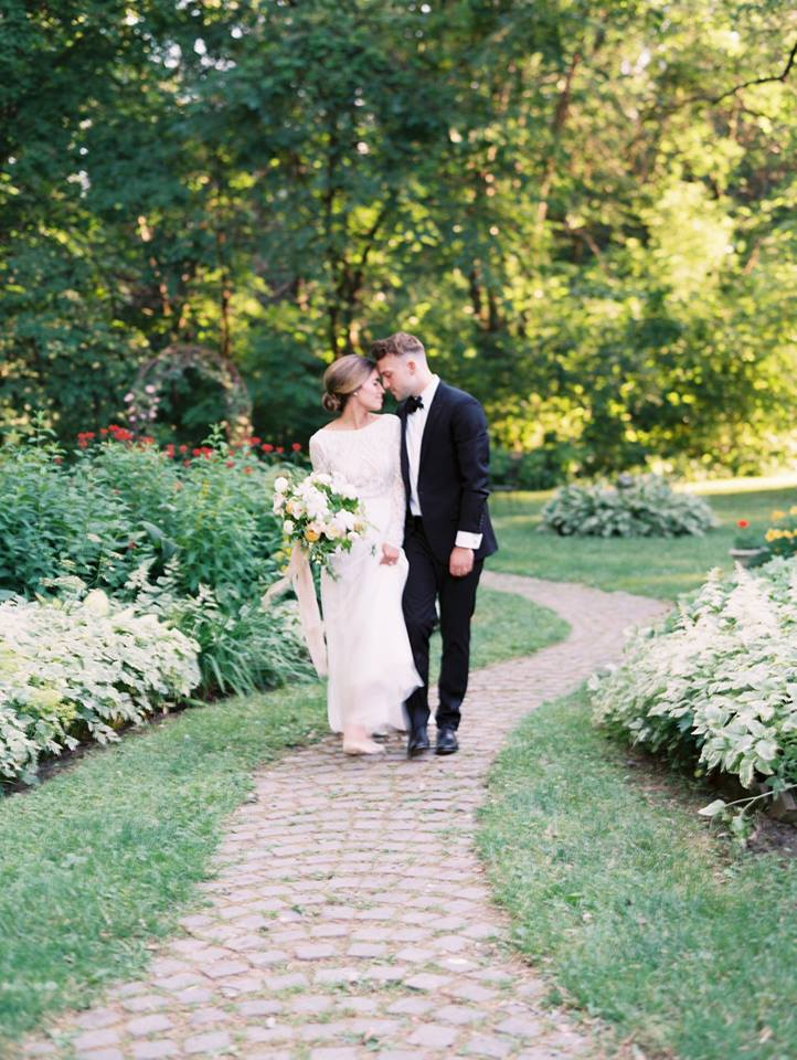 Bride and Groom gazing into one another's eyes on a cobblestone path.